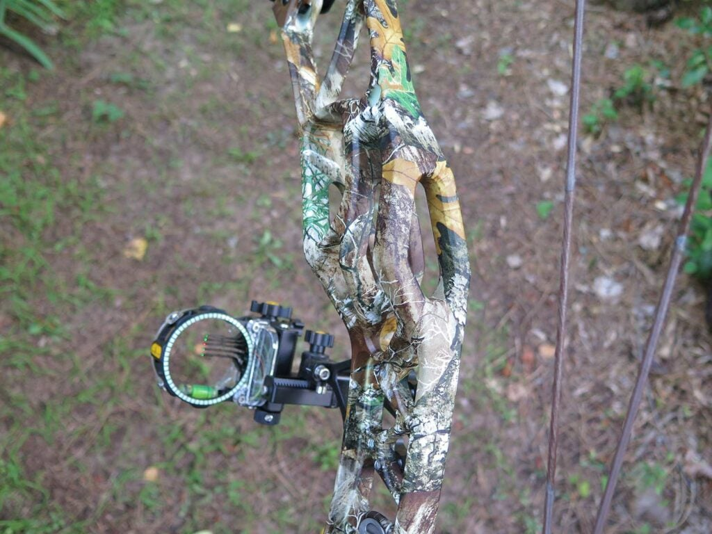 compound bow equipped with riser cage