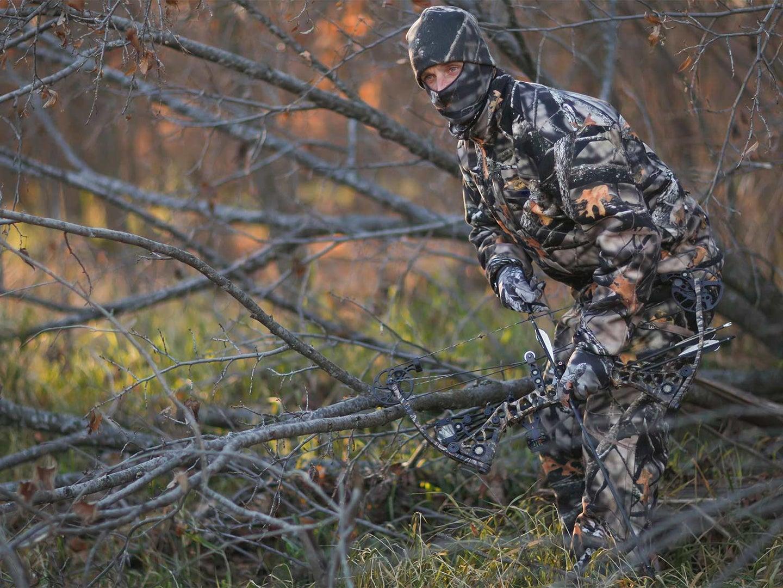 Hunter Ground Stalking Whitetail Deer