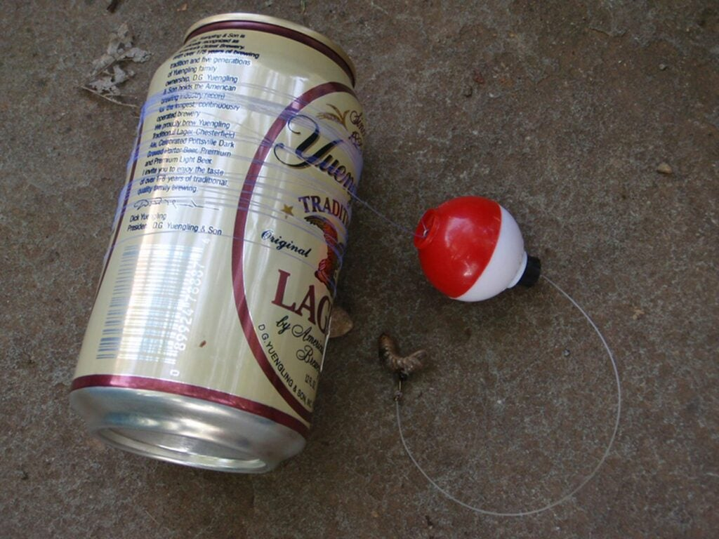 A beer can turned into a fishing reel.