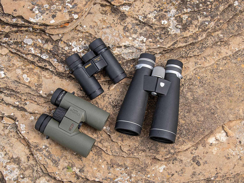 three binoculars on a stone ground