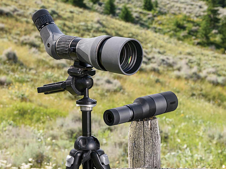 two spotting scopes in a field