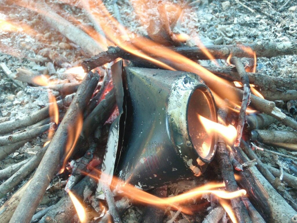 Burn up the can to make char cloth for flint and steel.