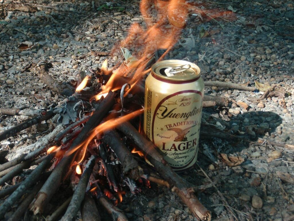 Use a beer can as a pot to boil water.