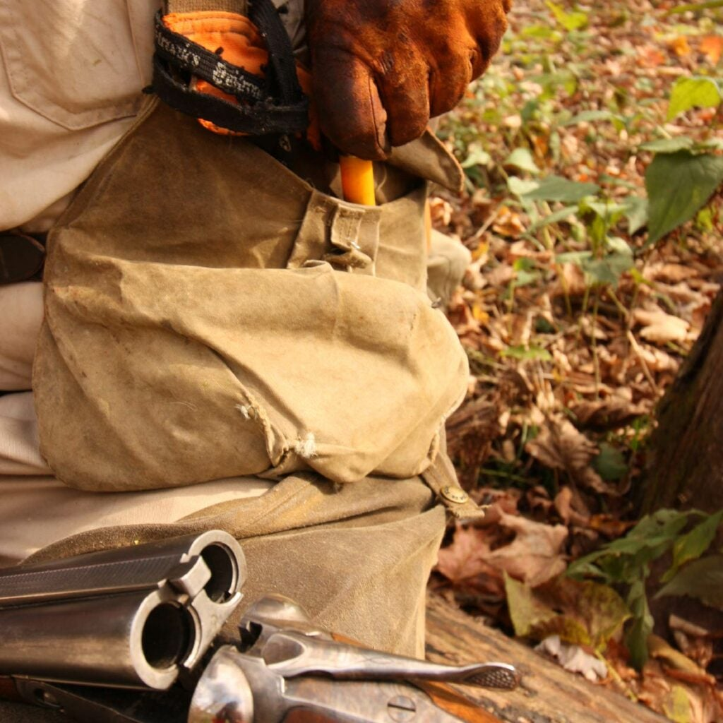 hunter changing ammo in a shotgun
