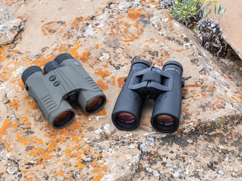 two rangefinding binoculars on a rock