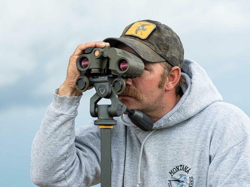 man testing steiner rangefinder binoculars