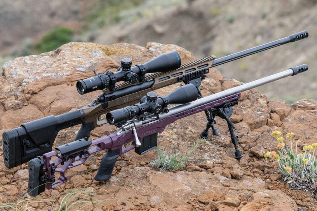 two rifles with precision scopes on tripods