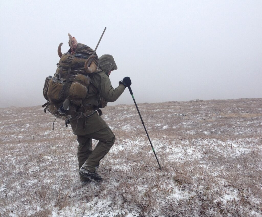 A hunter trudges through cold conditions.