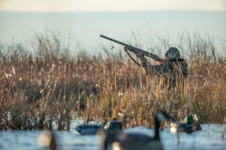 a waterfowl hunter in a lake