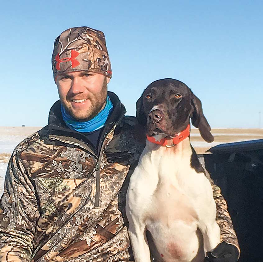 hunter with their hunting dog