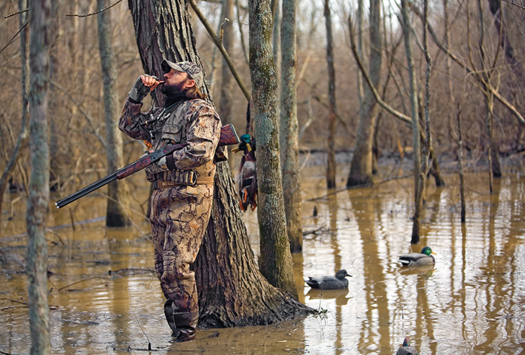 A waterfowl hunter calls in the next group of birds.