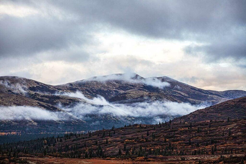 the hillside and mountain ranges of Alaska