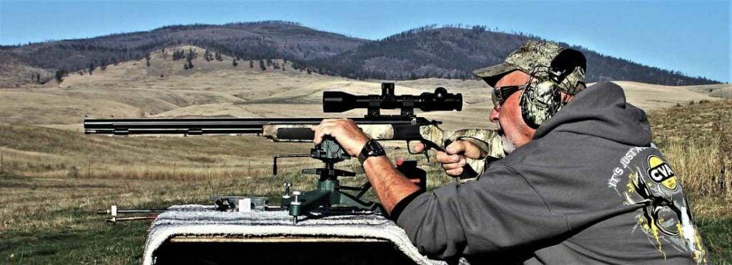man aiming a cva accura rifle