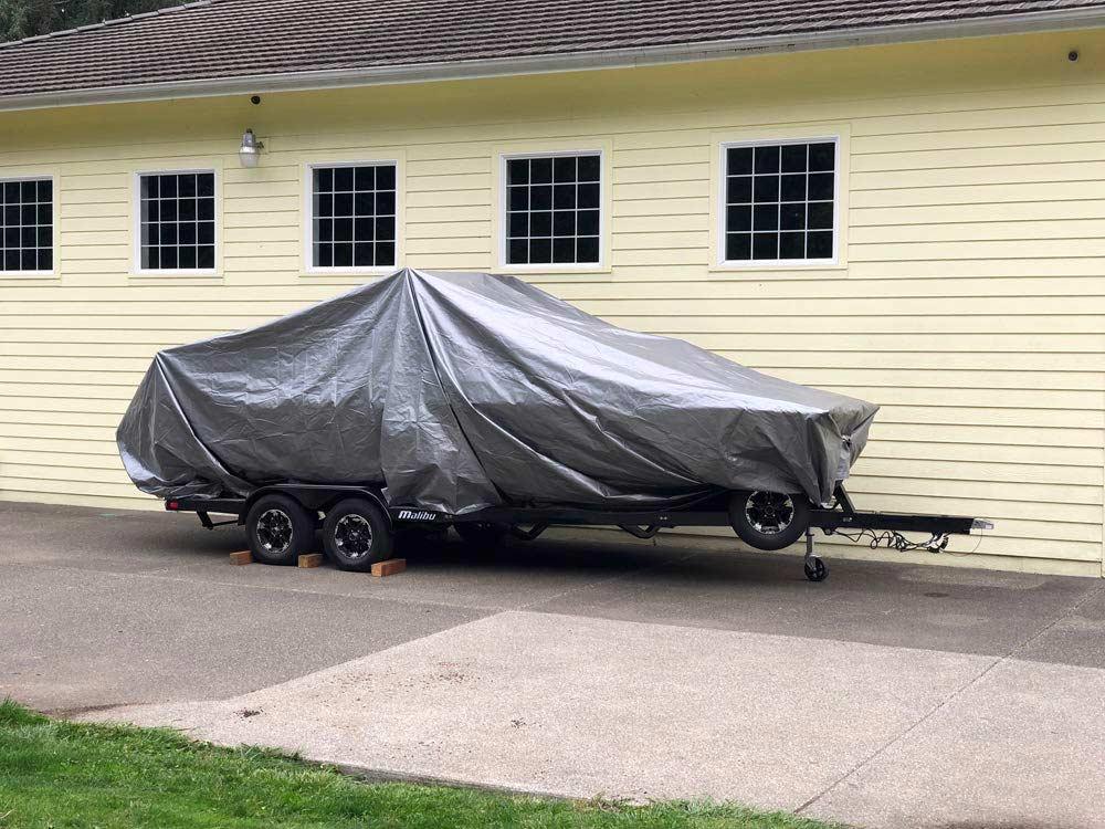 Gray tarp covering boat
