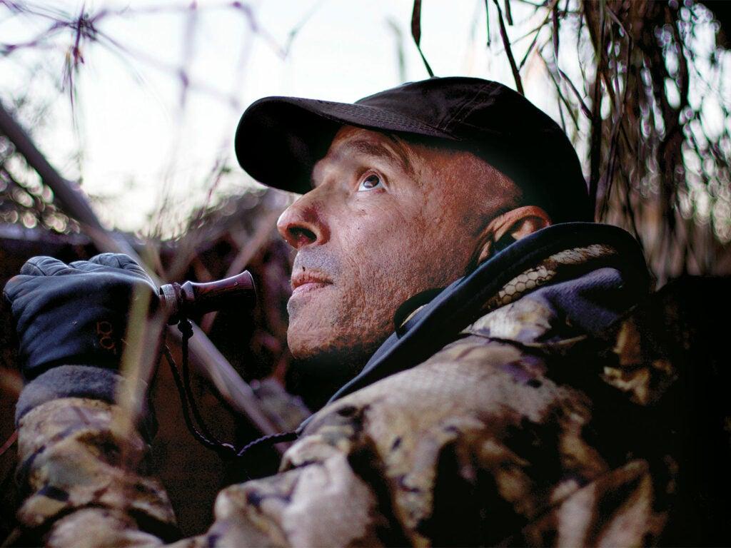 ramsey russell calling ducks in swamp