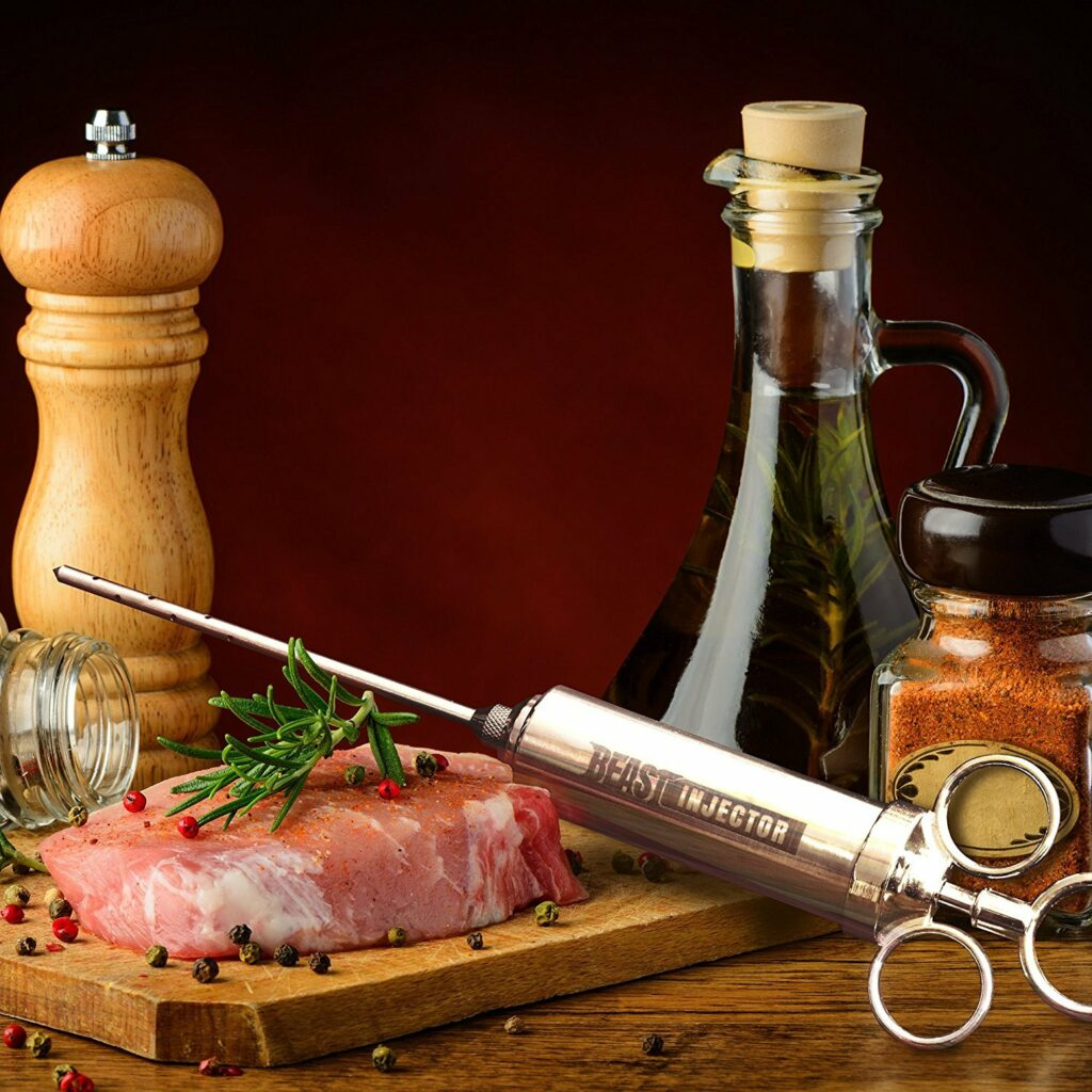 Meat Injector on cutting board with steak