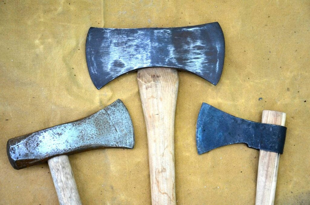 Pictured from left to right, the splitting maul, the double-bit ax, and the tomahawk.