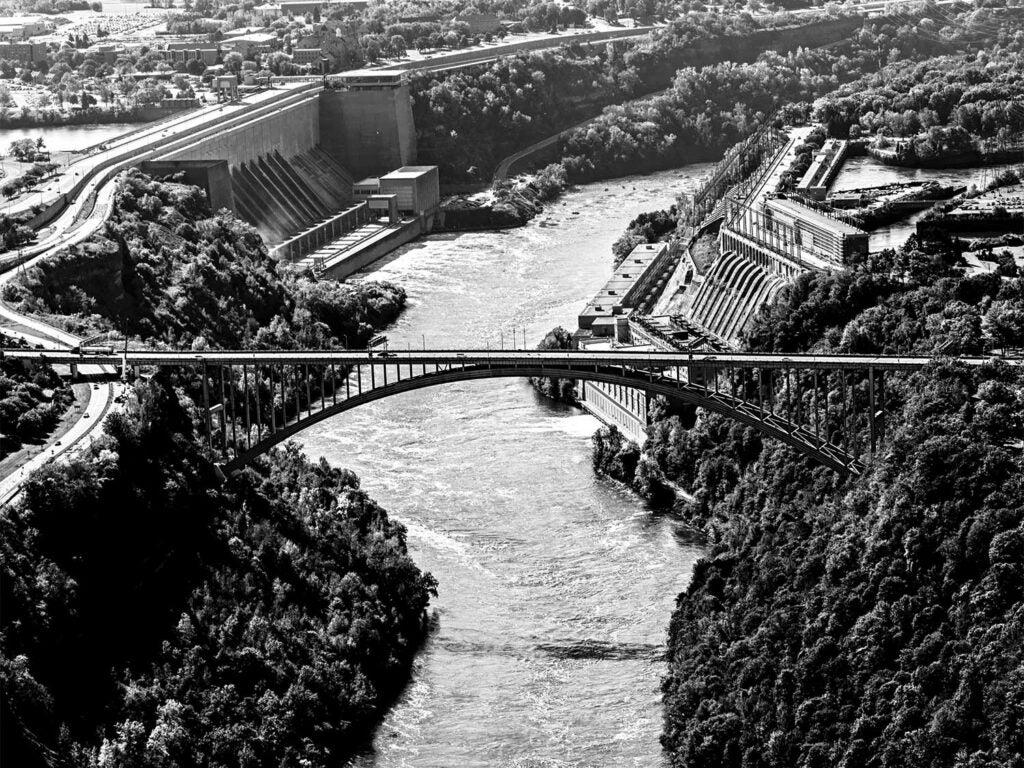 black and white photo of niagra gorge bridge
