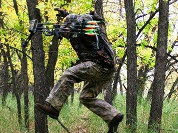 hunter jumping over a deer trail