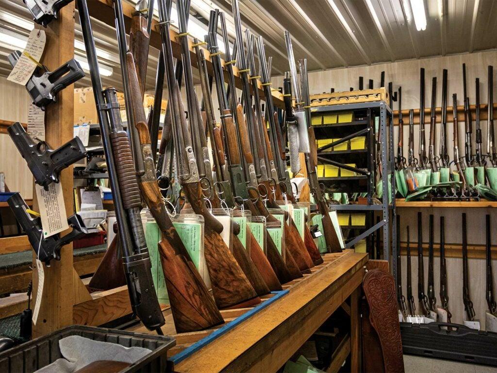 guns stored in a store-room on racks