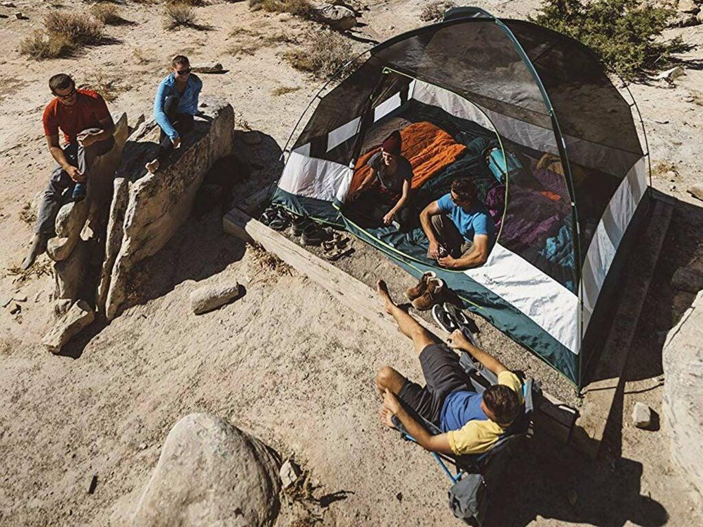 People around tent in dessert