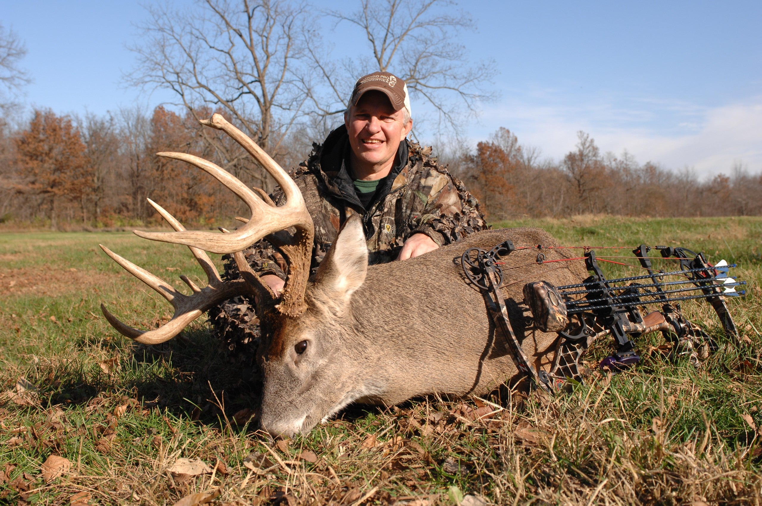 buck on the ground with hunter