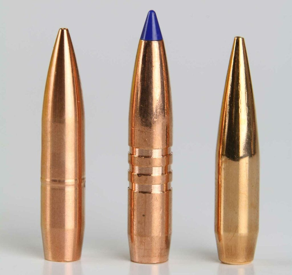 a lineup of bullets on a grey background