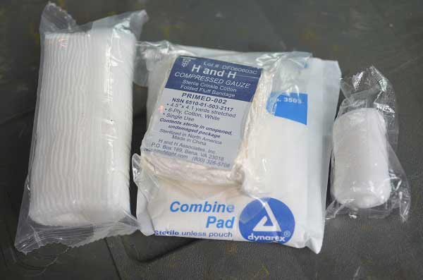 packages of different types of emergency medical gauze.