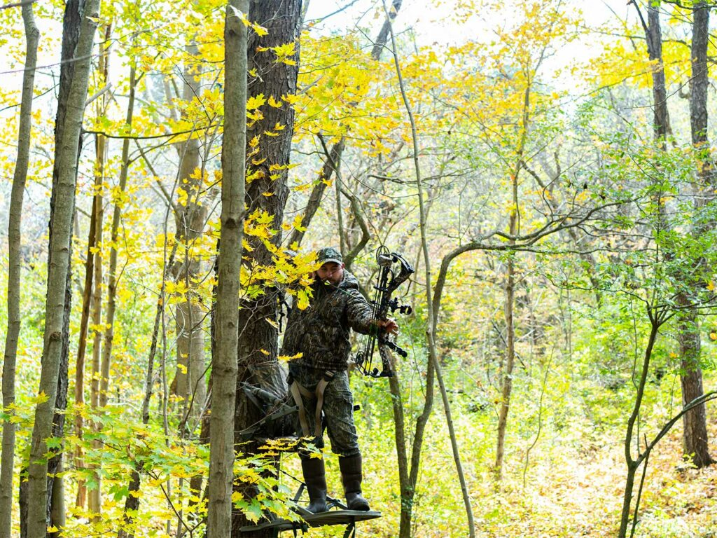 a hunter shooting from a climbing stand