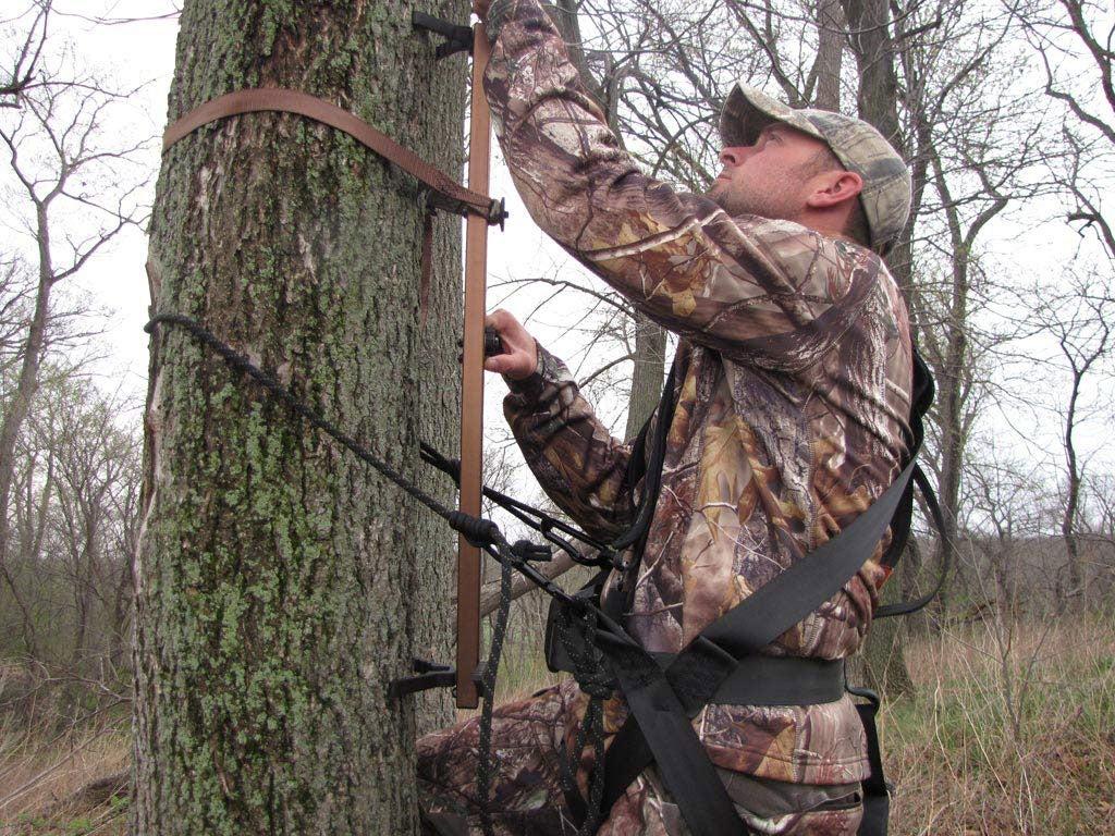 Hunter climbing a tree