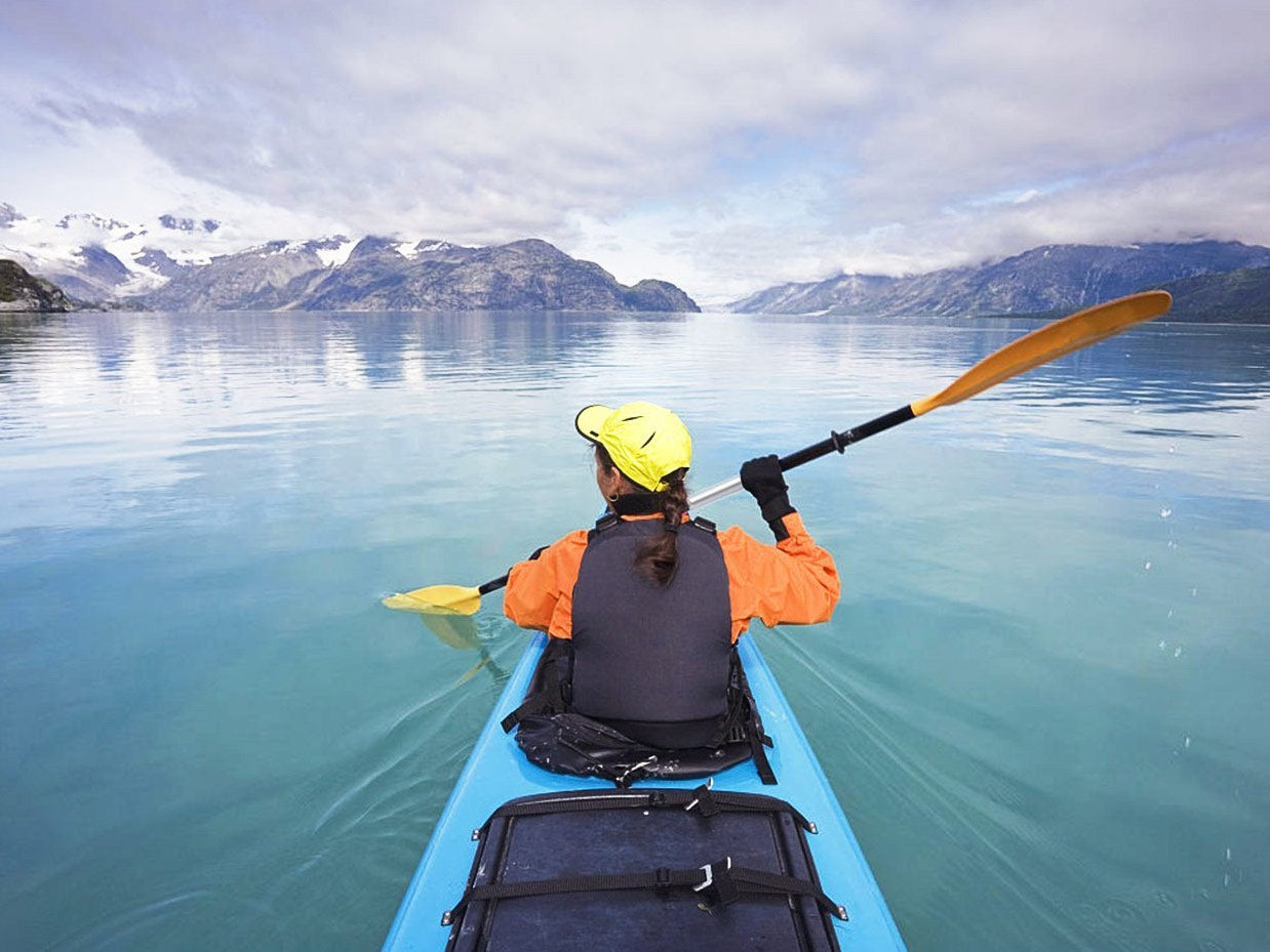 Woman kayaking over clear blue water