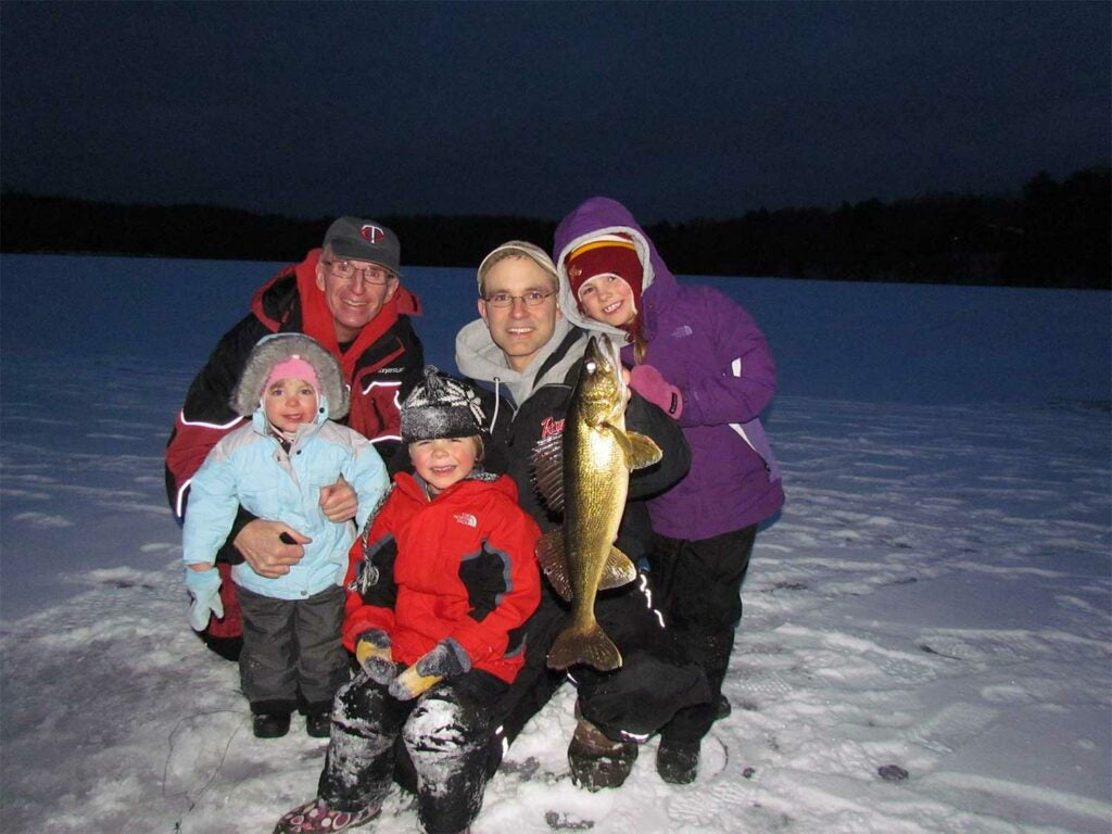 a family ice fishing with rattlebaits.