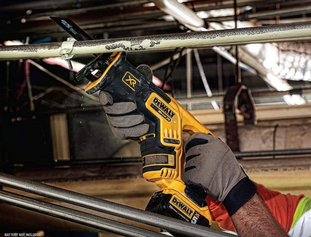 Man using a Dewalt reciprocating saw