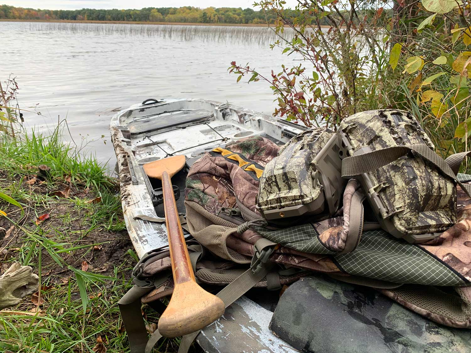 a fishing kayak filled with hunting gear