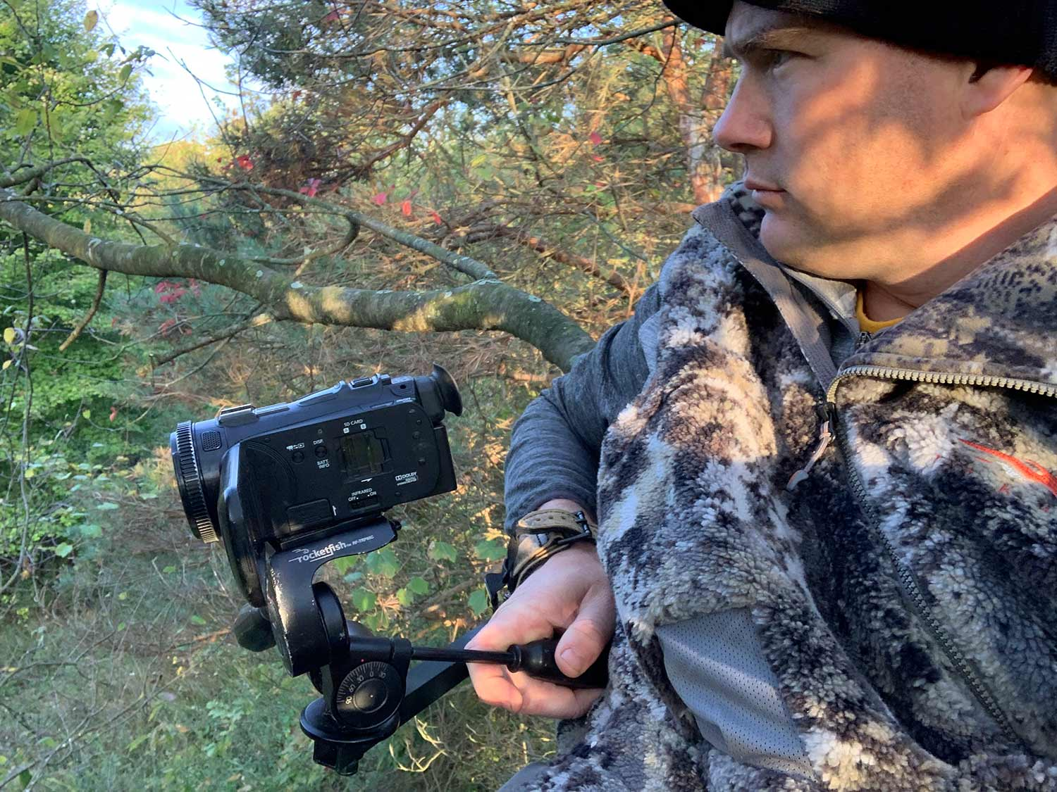 Hunter setting up a camera for a hunt