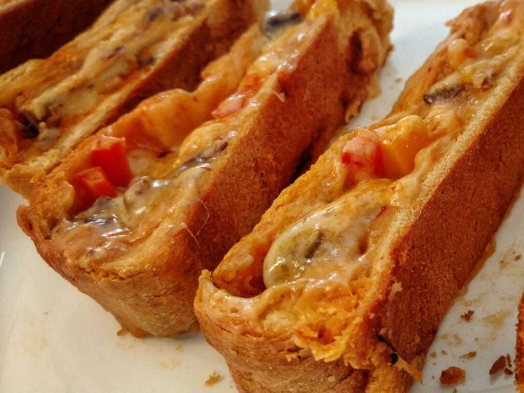 flakey cheese and pepper dove rolls