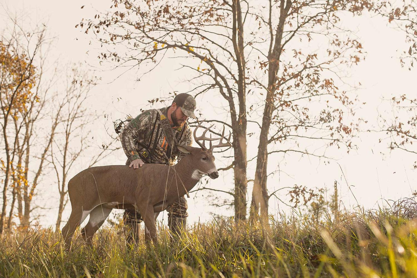 Michael Hunsucker sets up a Dave Smith deer decoy on private land in Iowa.