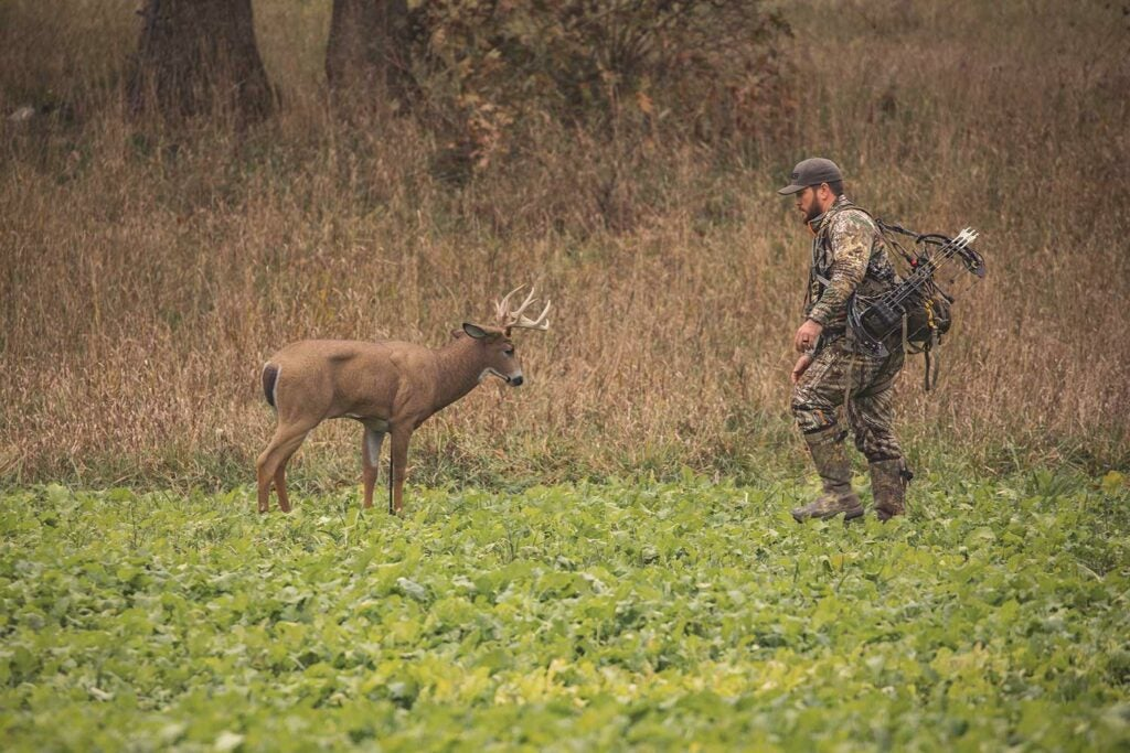 A hunter walking up to a decoy.