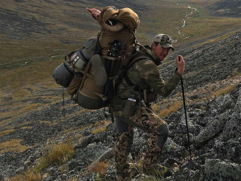 Hunter hiking through a rocky hillside.