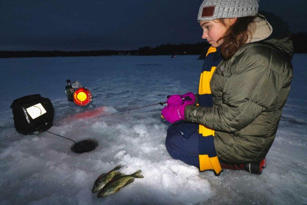 young girl ice fishing.