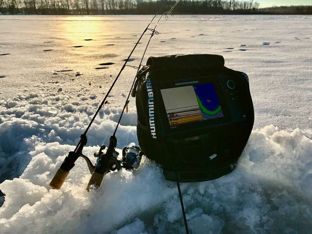ice fishing gear in the snow.