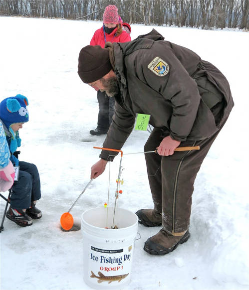 people fishing on ice in lake.