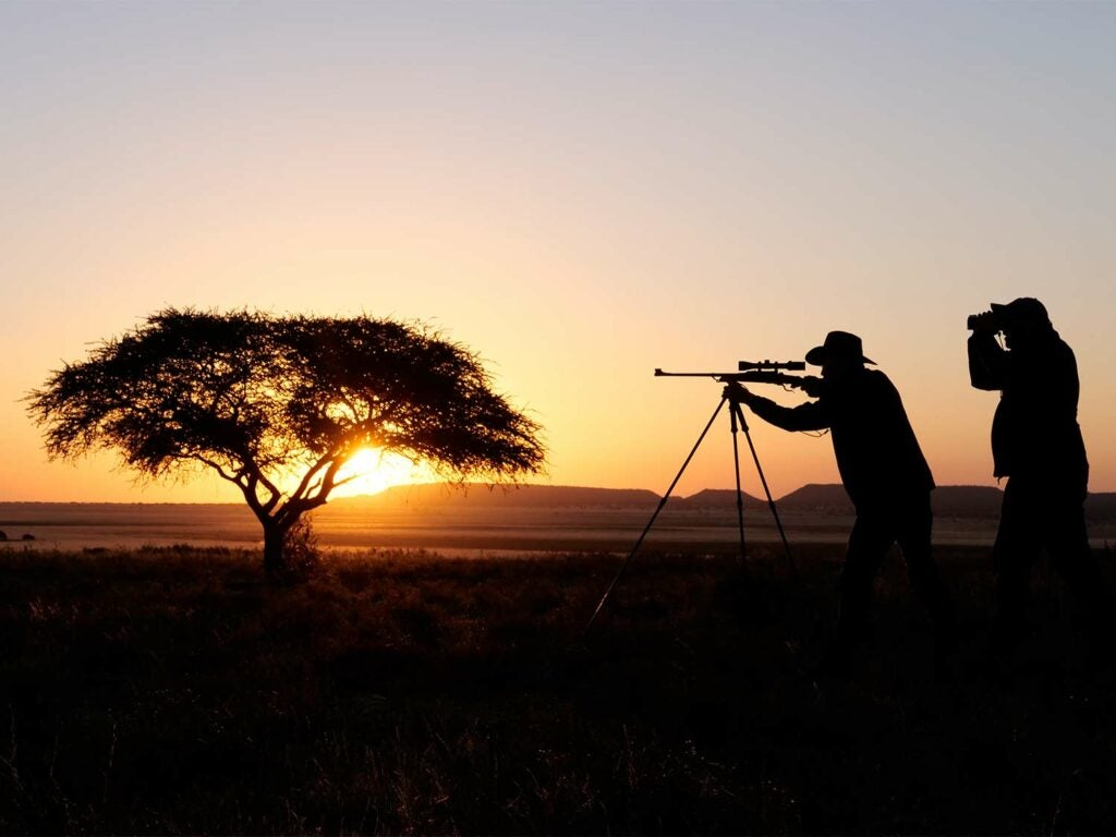 Hunters in Africa during the sunset.