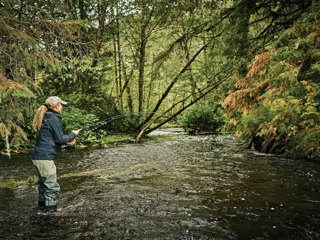 Denise Kaelke fights a Dolly Varden in Tongass National Forest.