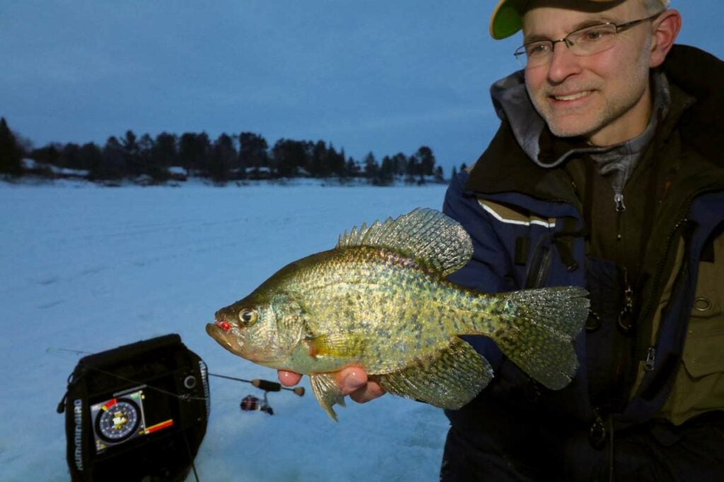 Low light periods focus midwinter crappie action on clear lakes.