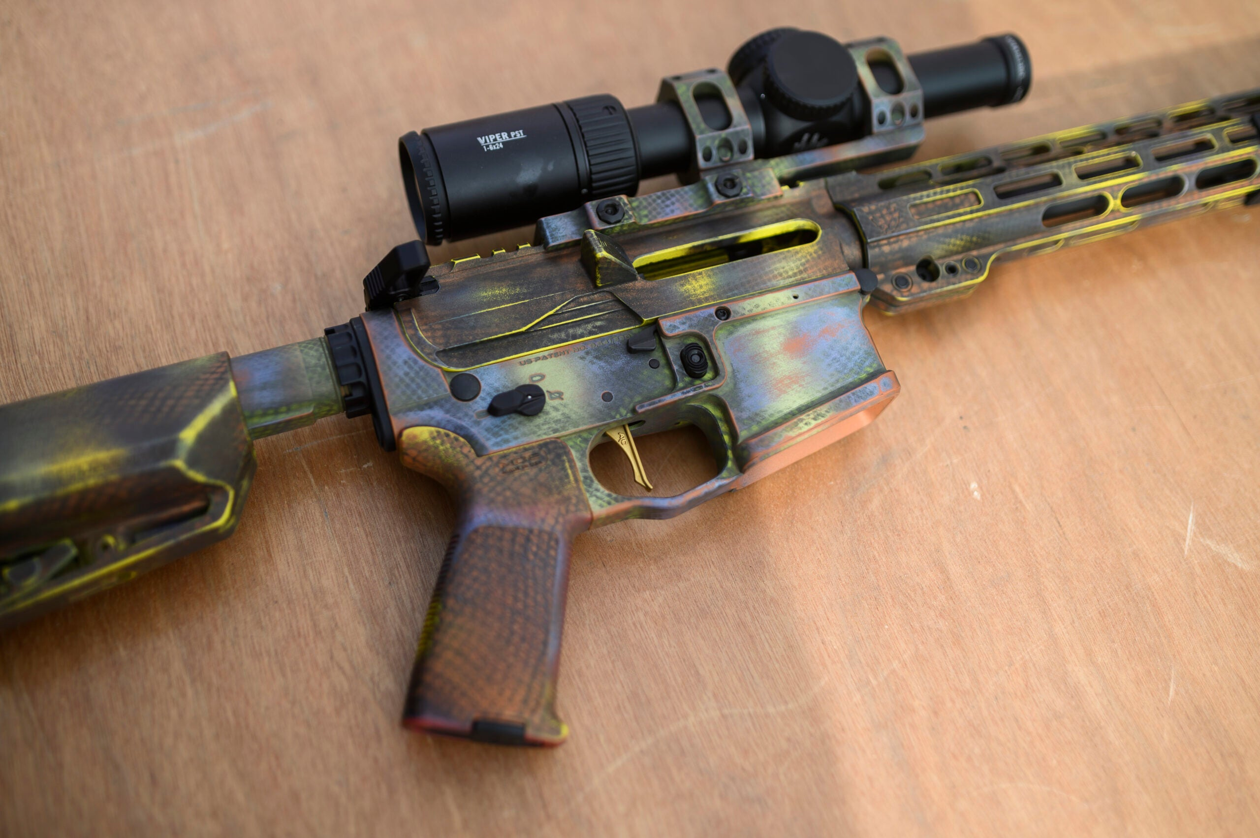 bight colored competition AR rifle topped with a Viper scope