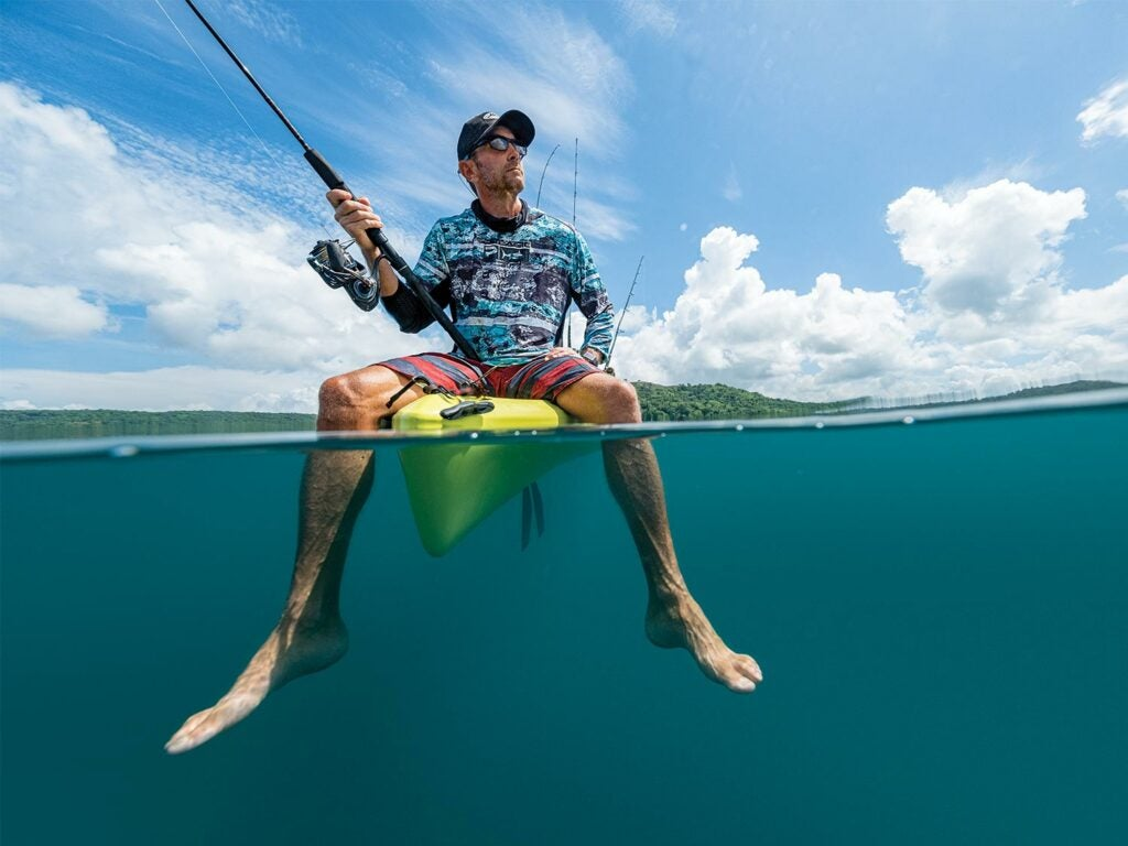 Lance Clinton fishing off a kayak in Costa Rica.