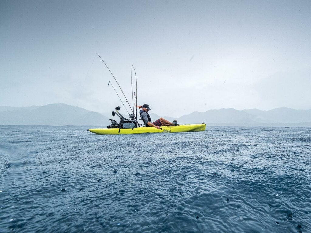 Lance Clinton fishing in a rain squall off Costa Rica.