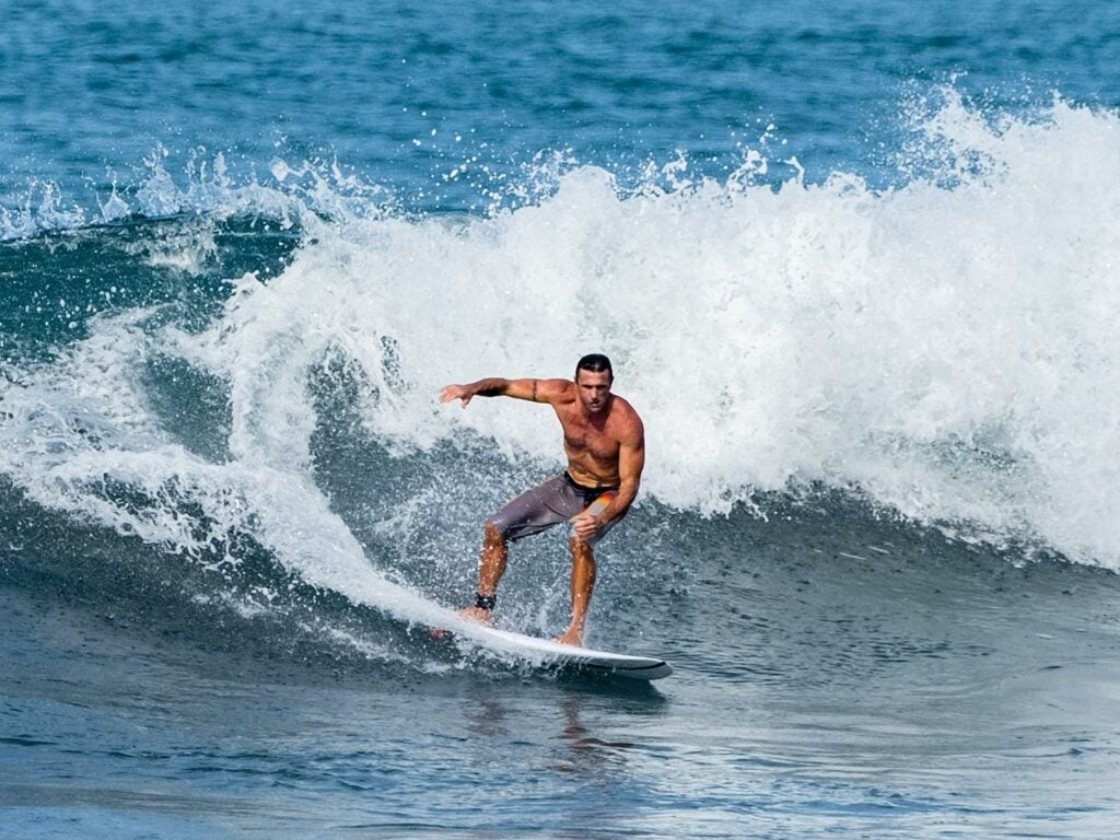 Lance Clinton rides the waves in Costa Rica.