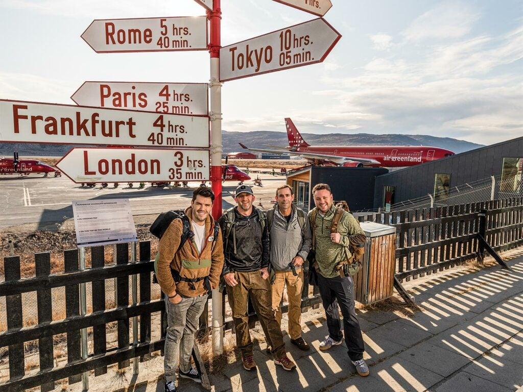 Group of men gathering at the Kangerlussuaq airpot.
